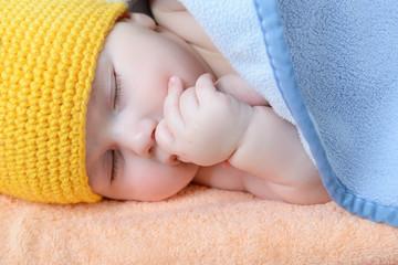 cute sleeping baby boy, beautiful kid dozing on plaid