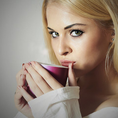 Beautiful woman drinking Coffee.Cup of tea.Hot drink.Blond Girl
