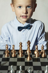 Smiling Little boy with chess.Smart kid.sport.Chessboard