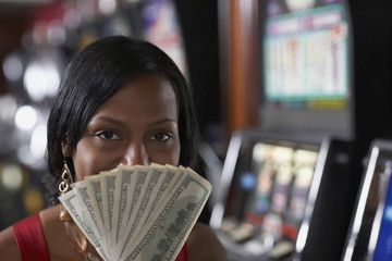 Mixed Race woman holding money