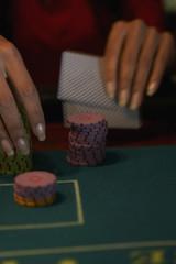 Close up of Hispanic woman gambling