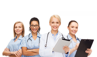 smiling female doctor and nurses with tablet pc