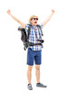 Smiling male hiker with raised hands gesturing happiness