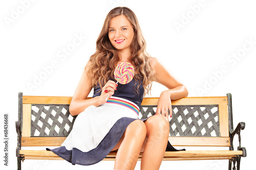 Fashionable female holding a lollipop