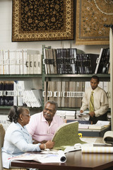 African American couple looking at flooring samples