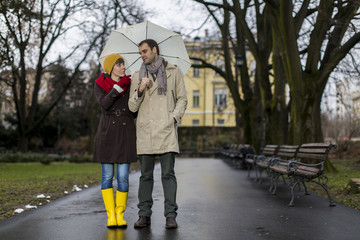 Romantic couple walking in the rain