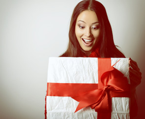 Young happy excited woman open gift box
