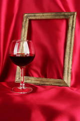 composition of frame and wine on bright background