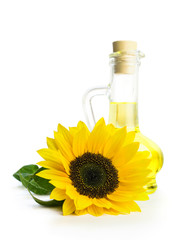 Glass bottle with sunflower oil and a sunflower