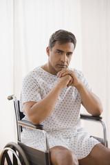 Hispanic man sitting in wheelchair