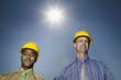 Multi-ethnic businessmen wearing hard hats