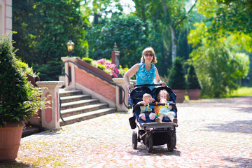 Woman with a double stroller