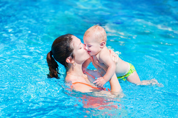 Mother and baby in swimming pool