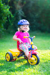 Toddler girl on a bike