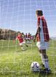 Multi-ethnic children playing soccer