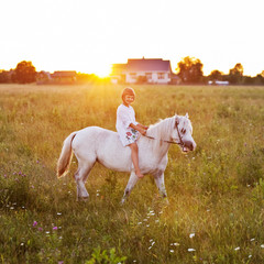 Little girl riding a horse