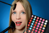 The beautiful girl with brushes make-up