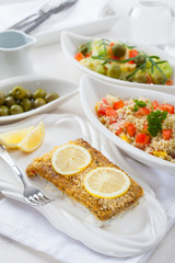 Baked fish fillet wih couscous salad