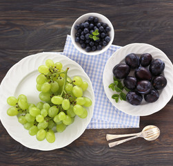 Plums, green grapes and blueberries