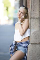 Casual teenage girl talking in the phone
