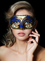 The beautiful girl in carnival mask