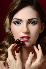 The beautiful woman with sweet cherry