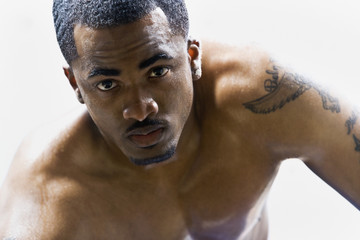 Portrait of bare-chested African American man