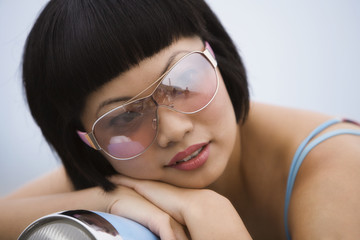 Asian woman wearing sunglasses