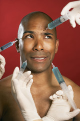African American man receiving injections in face