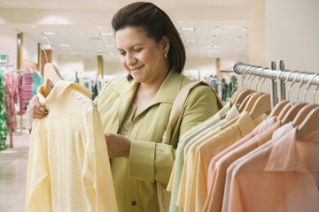Hispanic woman shopping for clothing