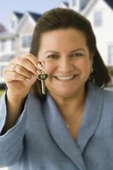 Hispanic woman holding house key
