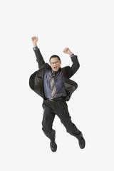 Asian businessman jumping