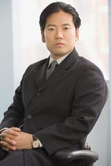 Asian businessman sitting in chair