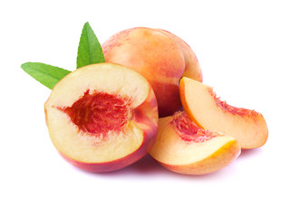 Ripe peach with leaf