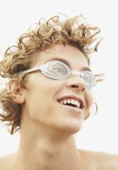 Teenaged boy wearing swimming goggles