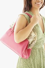 Asian woman holding handbag full of money