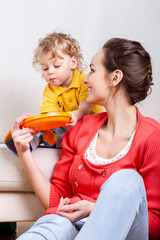Child eating while mom helps