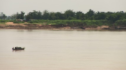 Fisherman in boat casting a net into the mekong  (1)