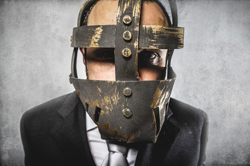danger, dangerous business man with iron mask and expressions