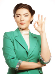 Happy businesswoman making an ok sign