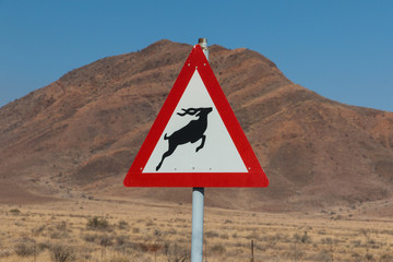 Roadsign antelope crossing in africa