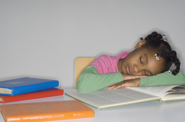 African girl sleeping on open book