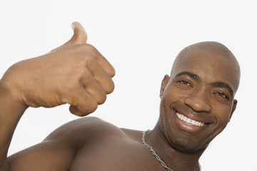 African man giving thumbs up