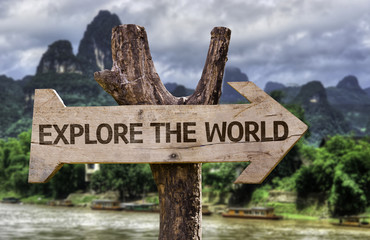 Explore the World wooden sign with a forest background