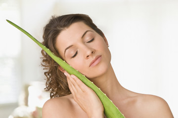 Woman hugging aloe leaf