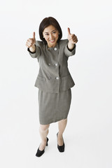 Asian businesswoman giving thumbs up