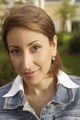 Portrait of Hispanic woman outdoors