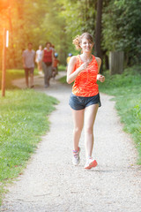 Beautiful Young Woman Jogging at Park