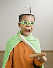 Mixed Race boy playing dress-up