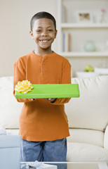Mixed Race boy holding gift